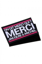 Ecusson rectangle velcro Jacquie et Michel : Ecusson rectangulaire brodé On dit merci qui? Merci Jacquie & Michel , dimensions 8,5 x 5 cm, avec dos Velcro.